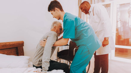 old man assited by his nurse